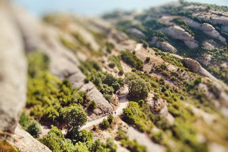 Aerial view of Montserrat mountain. Miniature tilt shift lens effect. Stock Photo
