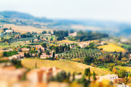 Panoramic view from San Gimignano in autumn, Tuscany, Italy. Miniature tilt shift lens effect.