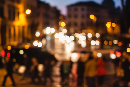 Blurred unfocused view of Rome at night. Italy