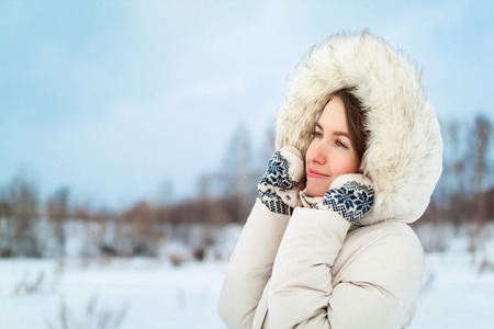 Christmas girl outdoor portrait. Woman in winter clothes on a snow field. Stock Photo - 83717712