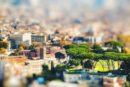 Cityscape view of central Rome taken from St Peter Basilica. Rome, Italy. Miniature tilt shift lens effect.