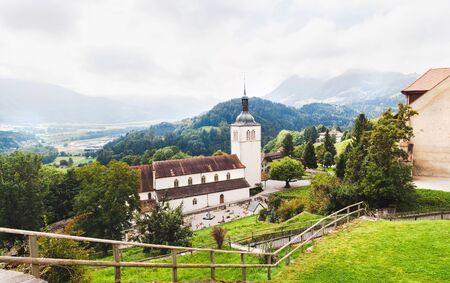 Panoramic view of Gruyeres and church. Switzerland Archivio Fotografico