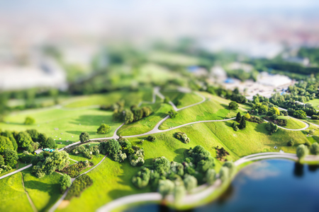 Aerial view of Olympiapark and Munich from Olympiaturm (Olympic Tower). Munich, Bavaria,  Germany. Miniature tilt shift lens effect