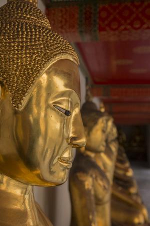 krung: face of buddha statue at Wat Pho temple. Bangkok, Thailand.