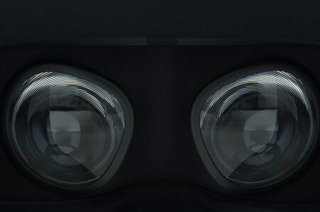 Closeup of fresnel lenses on a black virtual reality headset. Circular pattern on the glass and fabric around it. 写真素材