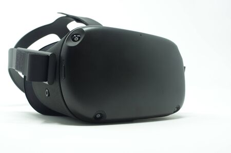 Black virtual reality headset isolated on a white background.