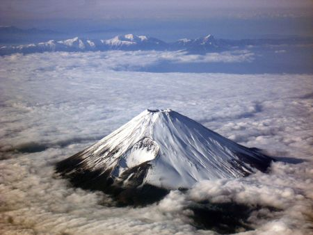 Winter View from a plane of Mount Fuji, Japan.  photo