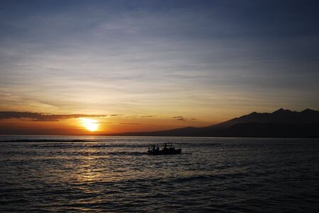 fishermens: Sunset with fishermens boat in Bali, Indonesia