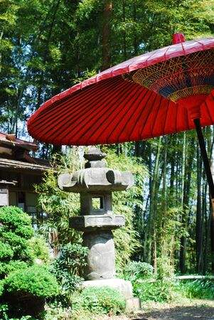 Red umbrella in a Japanese temple photo