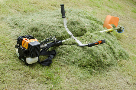 brush cutter puts on the haystack at noon during lunch break at high temperature