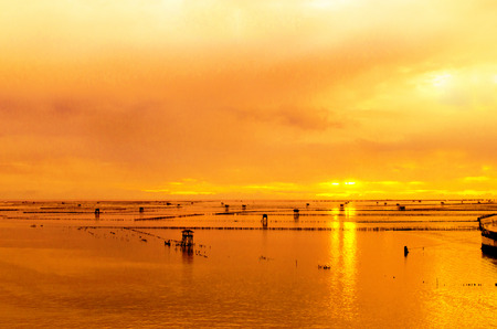 Sunrise on The Estuary ,Bangtaboon Bay and Cottages located in the sea. The accommodation of the fishermen ,Phetchaburi ,Thailand