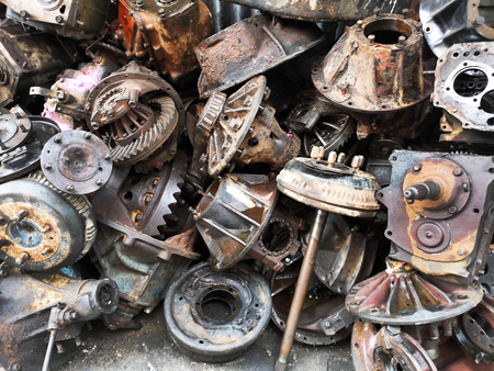 Assorted used and surplus car engines and other car parts are dirty and rusty at the junk yard wait for sell
