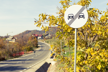 No more overtake restrictions road sign outdoors as safe driving concept