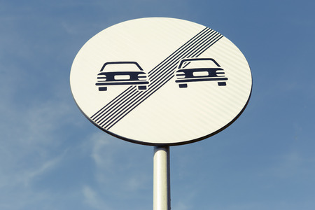 No more restrictions road sign on blue sky background as street traffic regulations concept Stock Photo