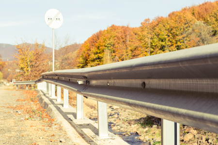 Road side protection or metal steel parapet and autumn nature background