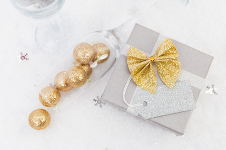 new year creative concept with blank label gift or present and champagne glasses stock photo
