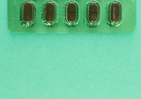 Closeup of natural herbal green tablets blister on copyspace and advertising text area Standard-Bild