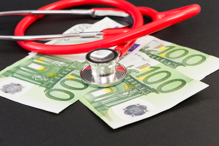 Closeup of euro bills and stethoscope as european health insurance concept Stock Photo