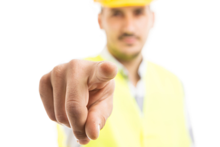 Building contractor pointing finger at camera with mad attitude as blame concept