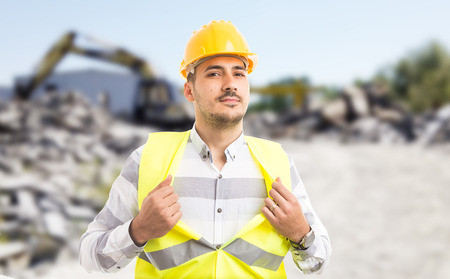 Professional worker acting like a superhero showing chest as powerful and successful construction builder concept
