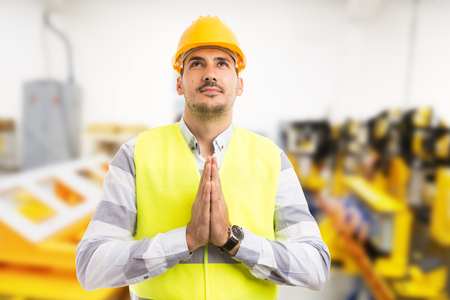 Factory worker technician or engineer praying gesture as hope wish expectations with palm together concept