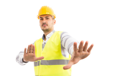 Engineer or foreman acting scared defending gesture isolated on white background