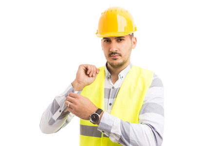 Professional engineer builder dressing or getting ready for work isolated on white background