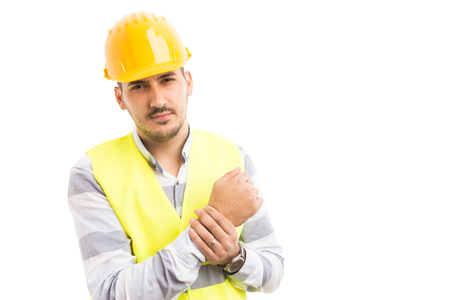 Construction worker suffering wrist or joint pain after too many working hours. Work injury concept isolated on white background.
