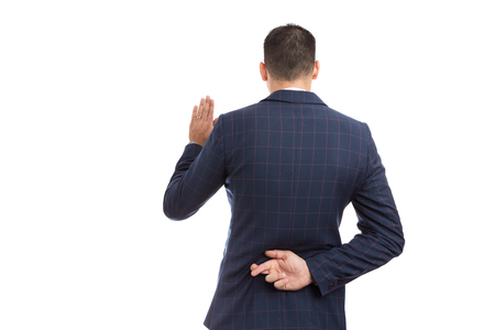 Fake oath vow gesture with fingers crossed behind back made by lawyer banker, broker or financial marketing manager Фото со стока