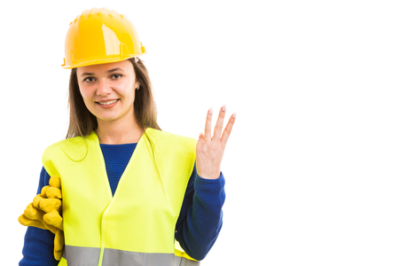 Young beautiful woman constructor showing number three with hand as builder sign concept isolated on white background Archivio Fotografico