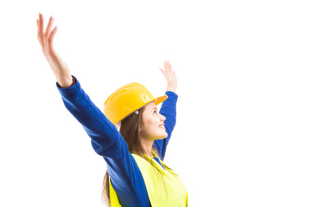 Young beautiful woman engineer or architect with arms stretched wide open as visionary successful female concept isolated on white background