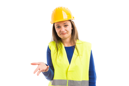 Young female architect making maybe gesture with hand as could be possibility concept isolated on white background 写真素材