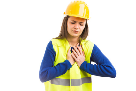 Young female engineer or architect pressing on painful chest with hands as heart attack failure concept isolated on white background