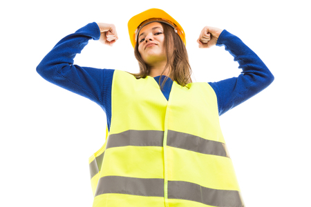 Powerful attractive young female architect or engineer rising arms as strong successful attitude isolated on white background