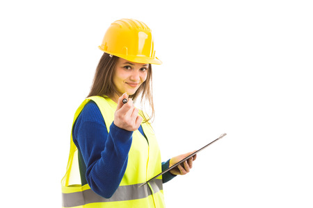 Young female architect or engineer holding clipboard and pointing with pen while smiling as happy professional concept isolated on white background