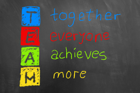 Together everyone achieves more colorful team chalk text on chalkboard or blackboard as teamwork cooperation motivation business concept