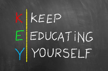 Key keep education yourself chalk text on blackboard or chalkboard as education motivational development success message