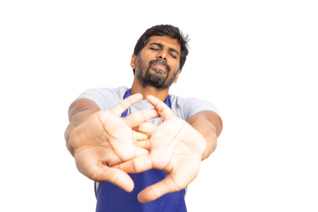 Supermarket or hypermarket indian male employee stretching knuckles as getting ready concept isolated on white background