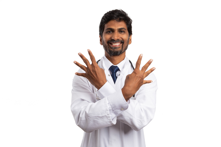 Indian friendly medic showing number four with both hands fingers raised isolated on white Foto de archivo