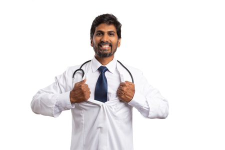 Indian medic doing superhero gesture opening coat as revealing concept isolated on white studio background