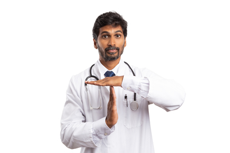 Indian doctor making time out sign with palms as break or pause concept isolated on white studio background