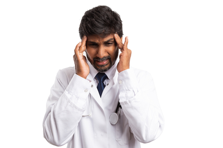Indian doctor touching forehead with fingers as hurtful headache gesture isolated on white background