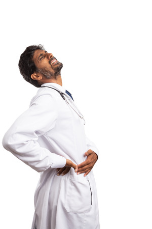 Indian doctor male touching side with suffering expression as having appendicitis isolated on white background Stock Photo