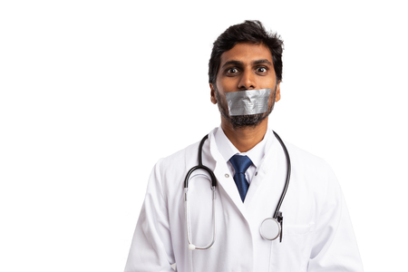 Indian doctor with duct taped mouth as professional secret concept isolated on white background Stock Photo