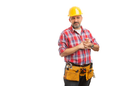 Shy constructor getting ready by cracking knuckles as nervous concept isolated on white background