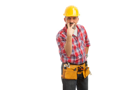 Mad builder making look at me sign with fingers isolated on white studio background 版權商用圖片