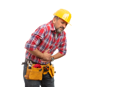 Sick builder with stomachache feeling nauseous isolated on white studio background Stockfoto - 117179945