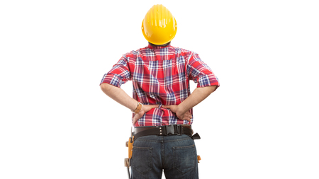 Builder touching painful stretched lower back because of physical work isolated on white background Banque d'images