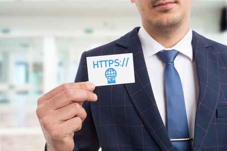 Businessman holding white card with hands as presenting website by showing https letters and computer connection symbol