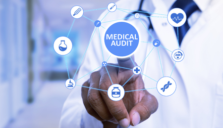 Closeup of medical audit text button pressed by indian doctor man with index finger on invisible display as futuristic technology concept Banco de Imagens